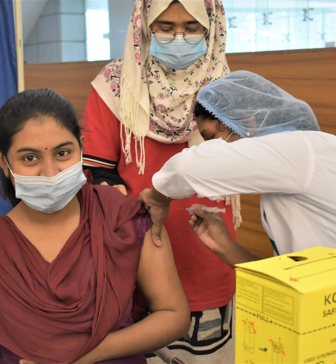 Frontline health worker receiving COVID-19 vaccine at Bangabandhu Sheikh Mujib Medical University Hospital (BSMMU).