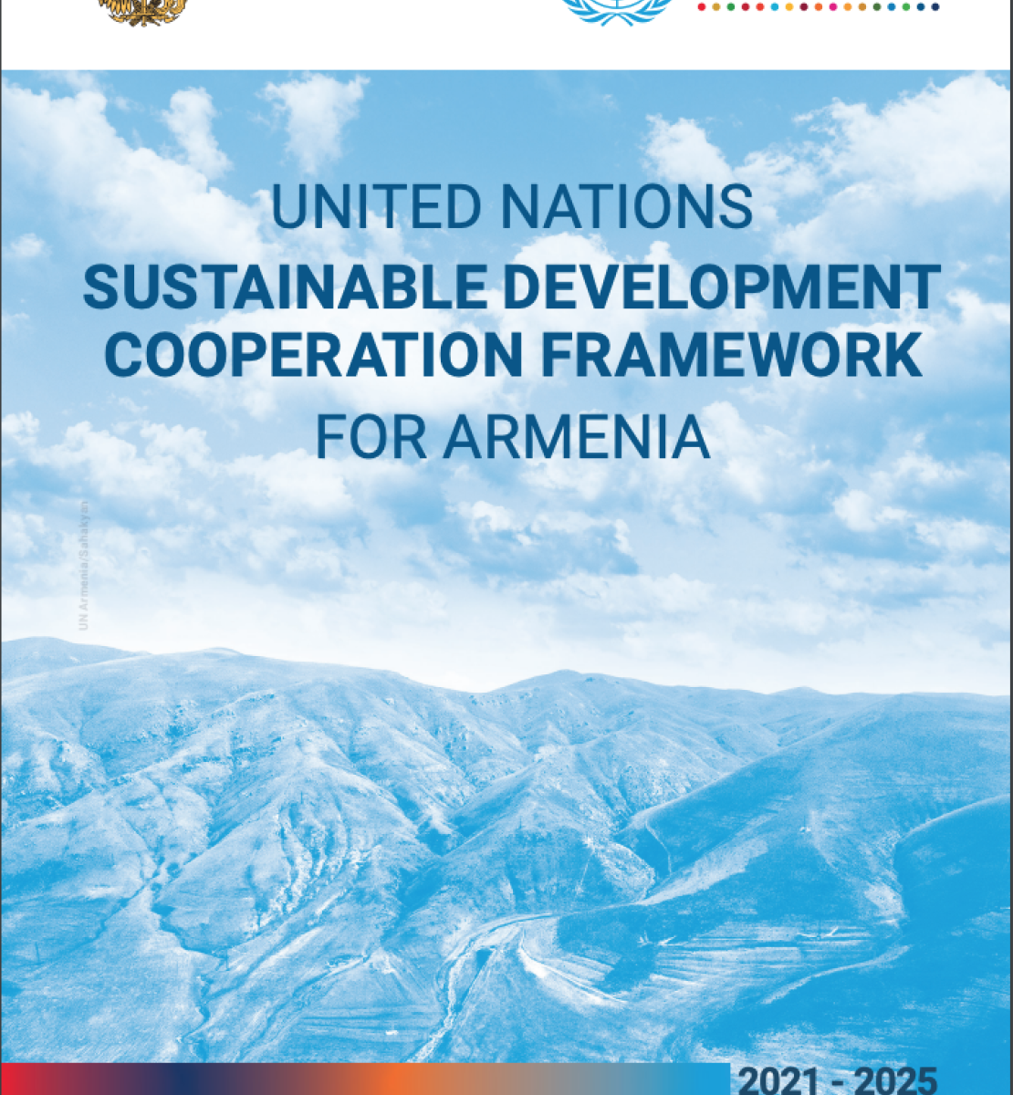 Cover of the document shows an aerial shot of mountains with the title of the document over the image with the government and UNCT logos above the title.